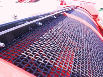Crimped trommel screen mesh is installed on the red machine.