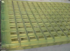 A piece of polyurethane vibrating screen mesh on the ground.