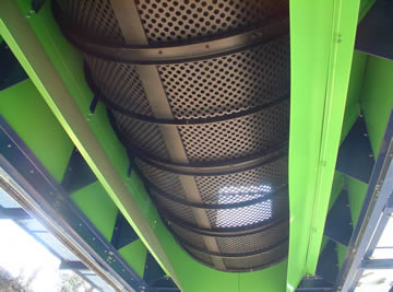 Upward view of round hole perforated trommel screen.